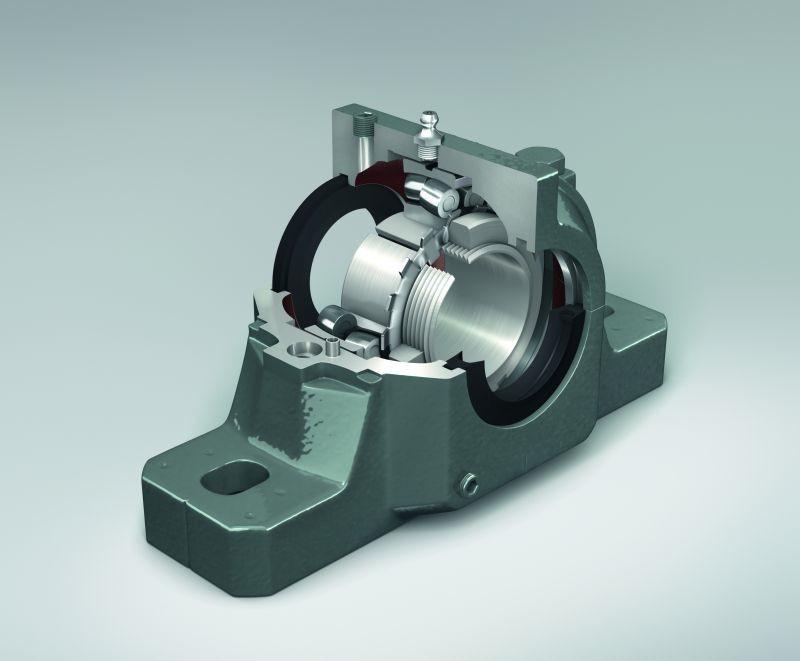 Vue en coupe montrant un palier à semelle NSK avec des roulements à rouleaux sphériques de grande capacité et des joints à labyrinthe.